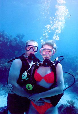 Couples scuba diving